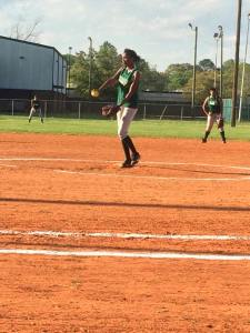 Philanesha pitching during her senior season of softball.